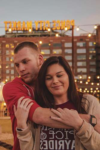 person couple hugging each other ponce city market