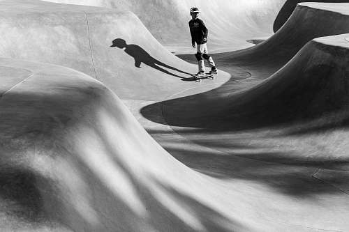 people greyscale photo of boy in the skateboard ring black-and-white