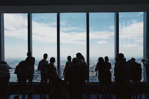 person group of people standing inside building new york