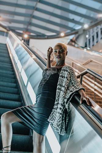person low-angle photography of woman on escalator people