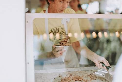 person man cooking cookies people