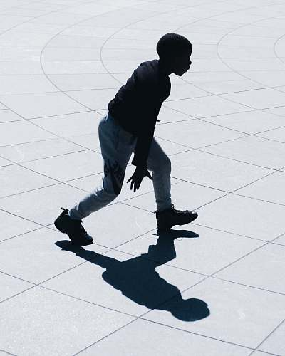 person man performing during daytime people