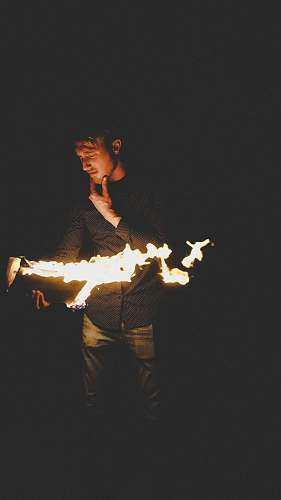 person man playing with fire people