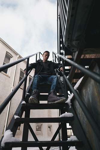 person man sitting on stairs people