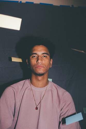 person man wearing pink crew-neck t-shirt pendant