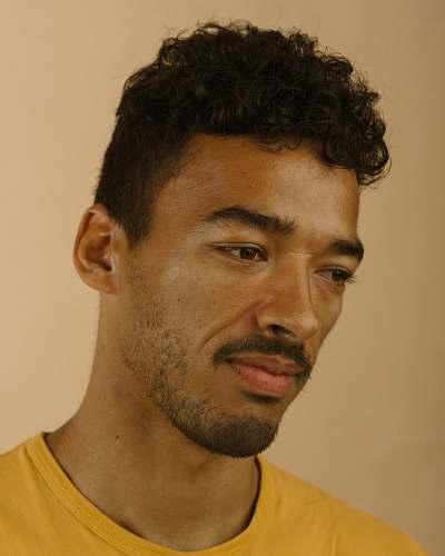person man wearing yellow shirt face