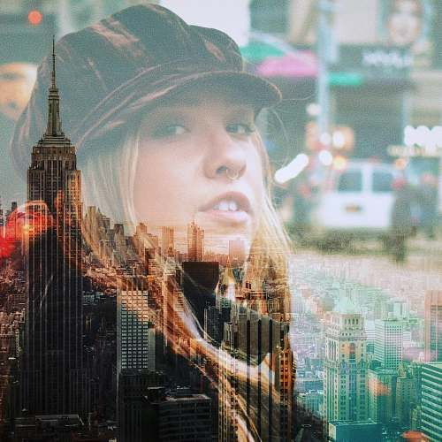 person New York City and woman's face overlay city