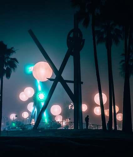 person paper lanterns at night lighting