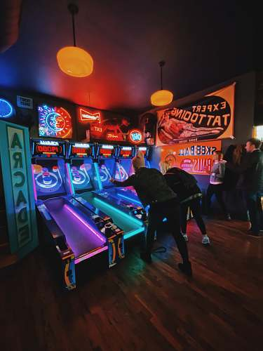 person people playing arcade game inside room st. louis