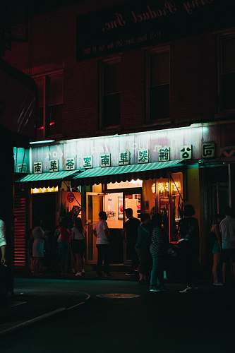person people standing in front of store during nighttime people