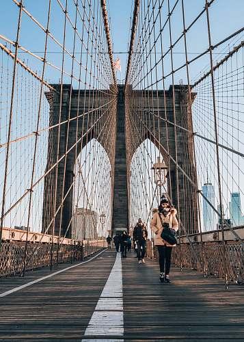 person people walking on bridge during daytime bridge