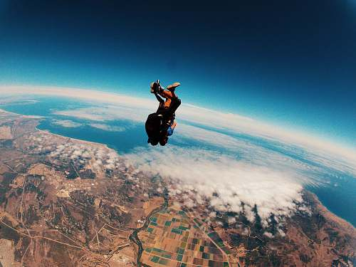 person person skydiving on air during daytime people