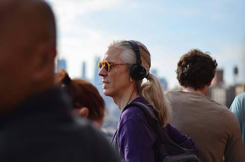 person person wearing purple jacket and headphones accessories