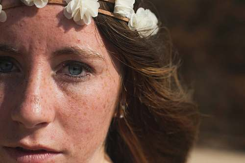 person portrait photo of woman wearing floral crown people