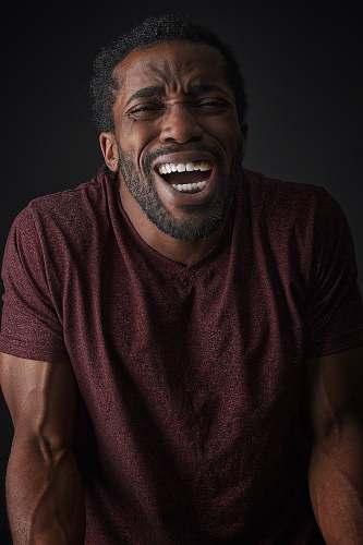 person smiling man wearing brown t-shirt face