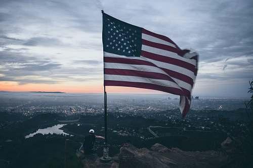 person waving USA flag symbol