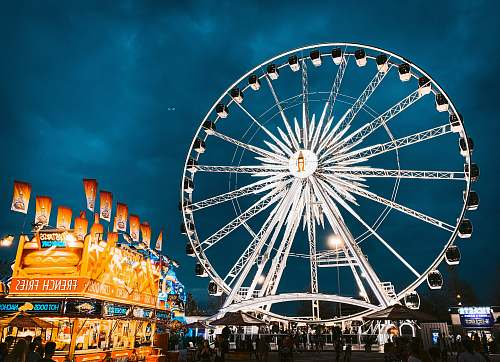 person white ferris wheel with lights amusement park