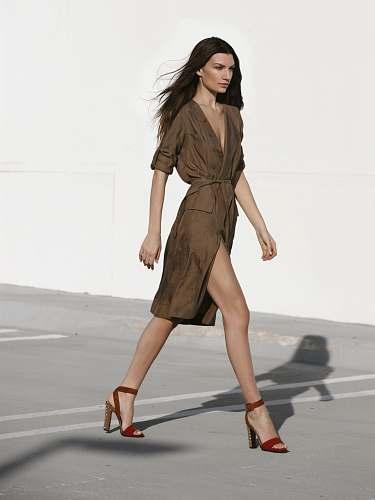 person woman in brown dress walking on gray asphalt road people