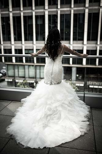 wedding woman in white wedding dress standing in front balustrades bride