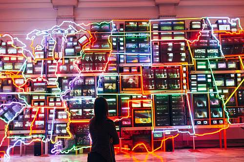 person woman looking at monitors with light decor people