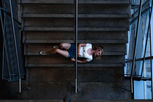 person woman lying on stairs people