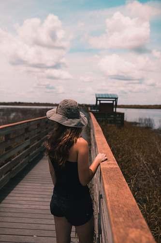 person woman standing on boardwalk people