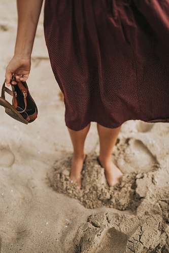 mud woman stepping on brown sand soil