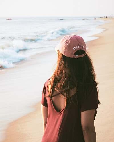 apparel woman walking on sea shore clothing