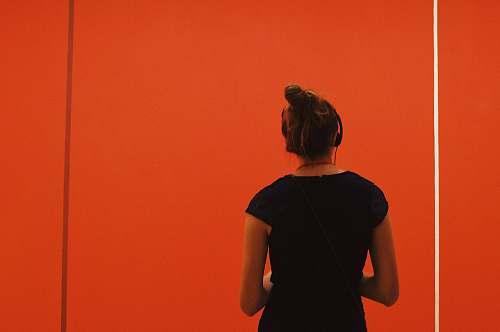 person woman wearing headphones apparel