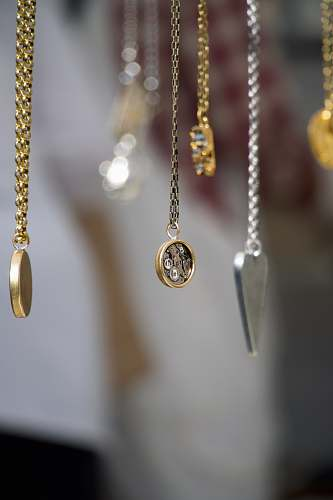 gold gold-and-silver-colored pendant necklace locket