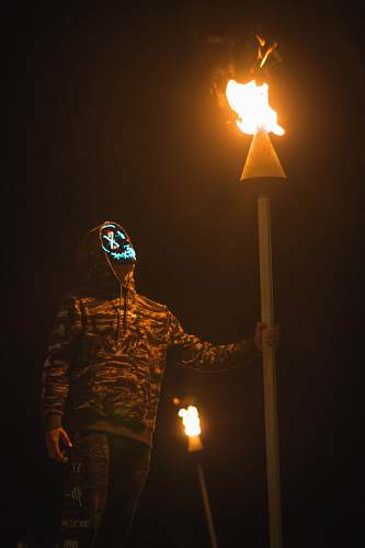 united states person holding torch while walking at night hilo