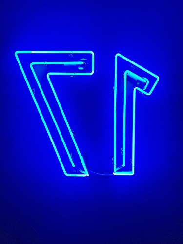 neon blue letter y on blue background blue