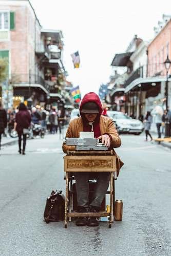suitcase man sitting on table typing on typewriter human