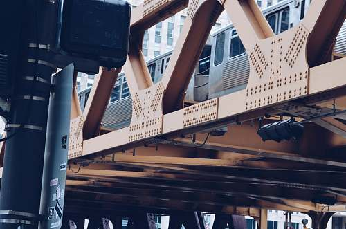 suitcase train passing on hanging railway during daytime chicago