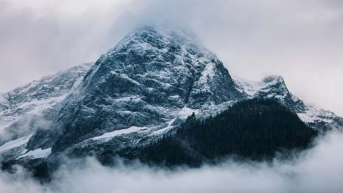 nature gray mountain covered in snow at daytime peak