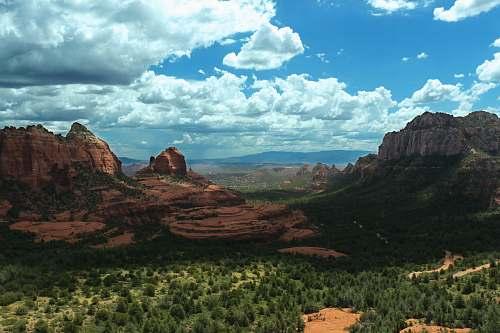 valley mountain peak during daytime canyon