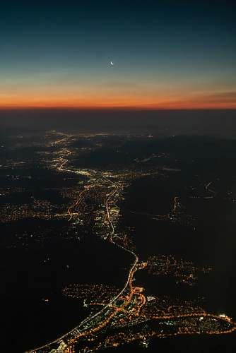 dawn aerial view photo of gray city dusk