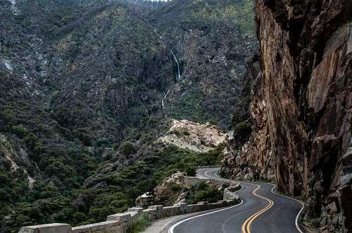 road asphalt road beside cliff kings canyon national park