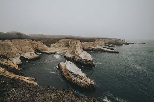 outdoors bird's-eye view photography of ocean land