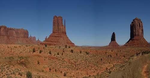 monument brown landmark during daytime desert