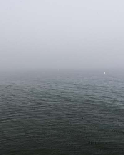 grey calm body of water weather