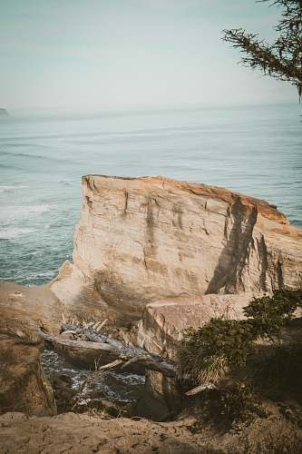 outdoors gray rock formation during daytime cliff
