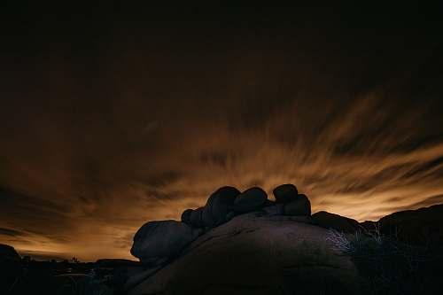 sunrise gray rocks under sunset joshua tree national park