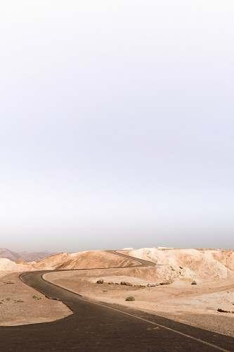 desert grey asphalt road on desert during daytime death valley