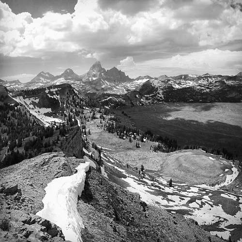 black-and-white greyscale photography of mountain hill cover with snow mountain