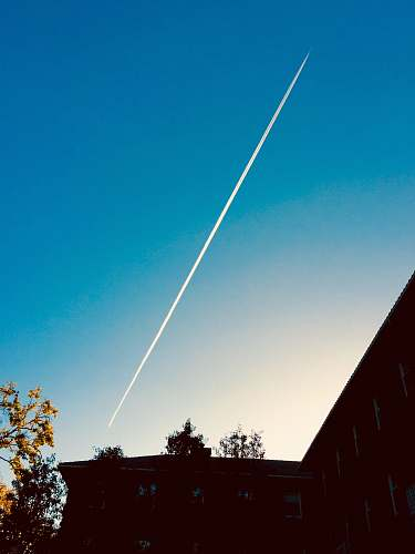 outdoors jet plane under blue sky flare