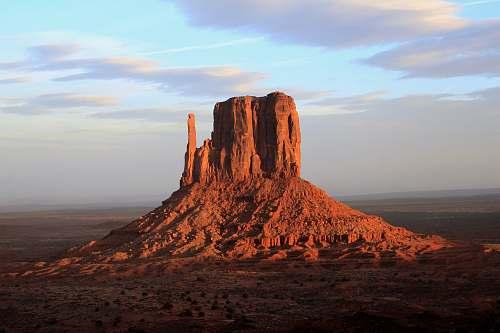 desert landscape photo of monolith outdoors