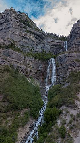 outdoors landscape photo of mountains and waterfalls river
