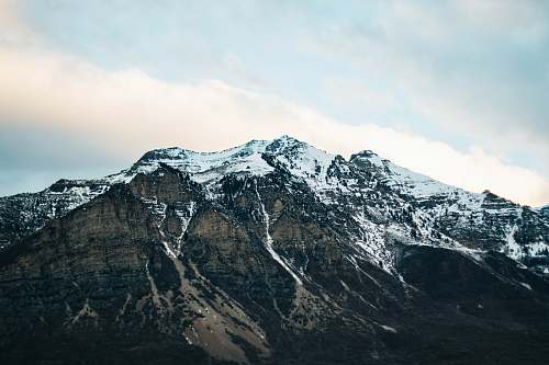 outdoors landscape photography of mountain covered with snow under the clear sky mountain