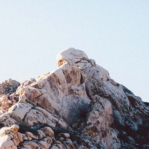 rock landscape photography of mountain cliff